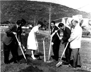 A group of people with picks and shovels at the July 1961 groundbreaking ceremony for the Health Research Institute Building